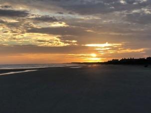The setting sun on the beach...